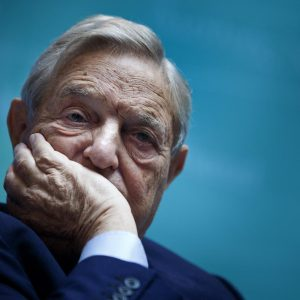 George Soros, Chairman of Soros Fund Management, listens during a seminar titled